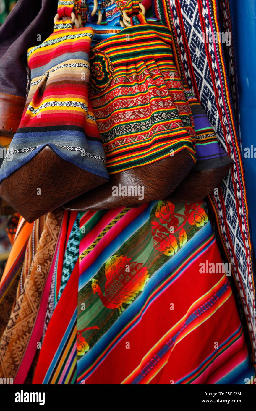 Local carpets made of llama and alpaca wool for sale at the market, Cuzco, Peru, South America - Stock Image