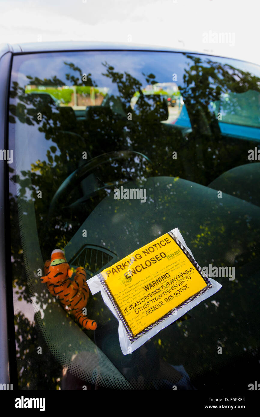Parking ticket on car windscreen. - Stock Image