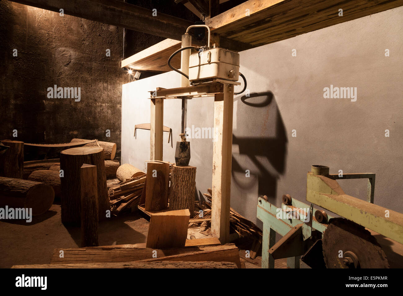Display of splitting French oak to make the aging barrels. - Stock Image