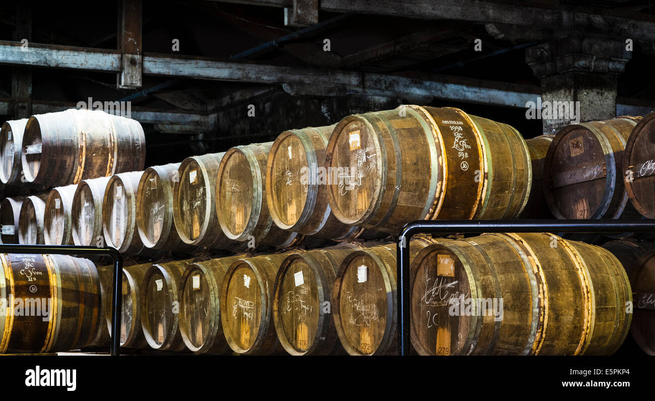 Hennessy ageing warehouse where the eaux-de-vie are stored in oak barrels to mature before blending. - Stock Image