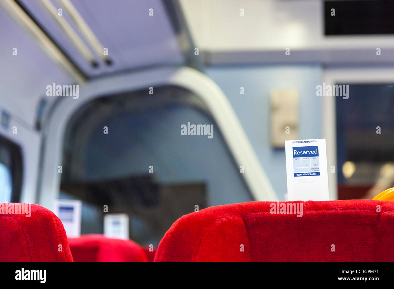 Train reservation ticket attached to the back of seating for a reserved seat on an East Midlands Trains train, England, - Stock Image
