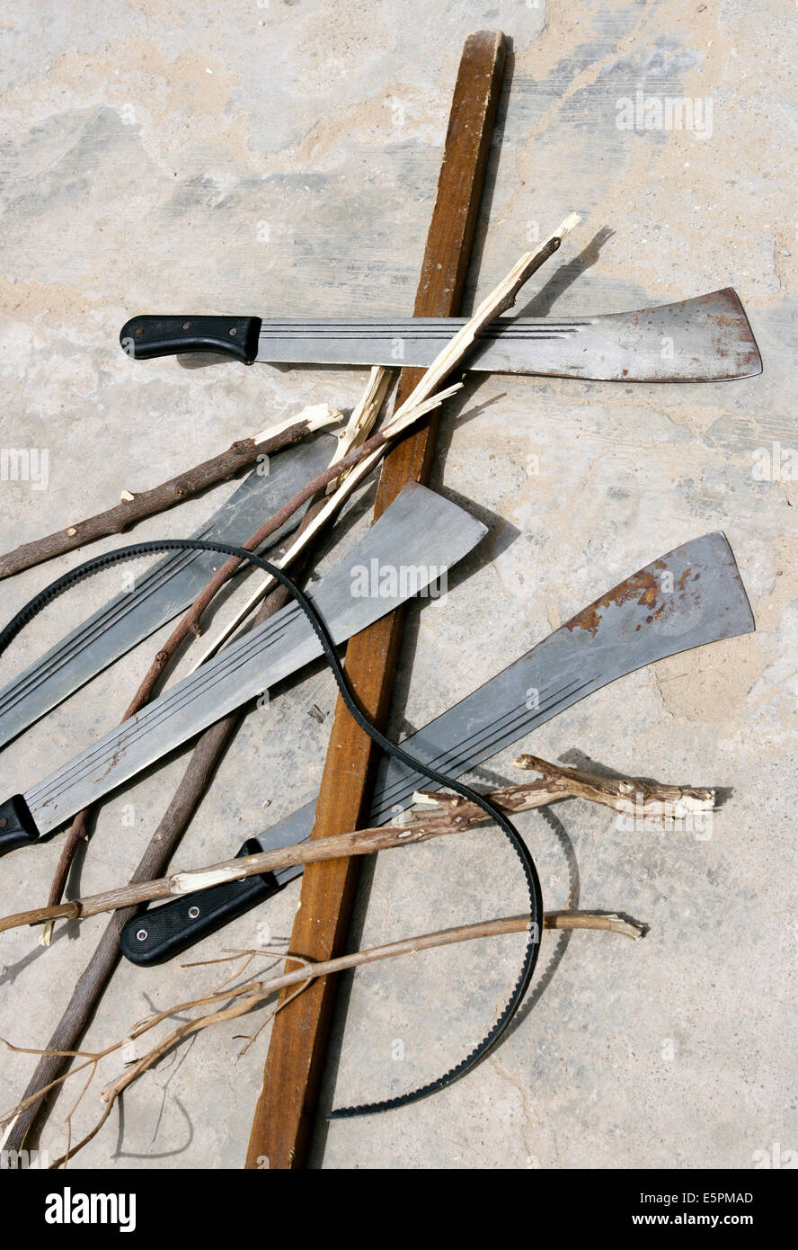small weapons, clutches, knifes, sticks, laid down in a form of a christian cross. City of Maiduguri, Nigeria - Stock Image