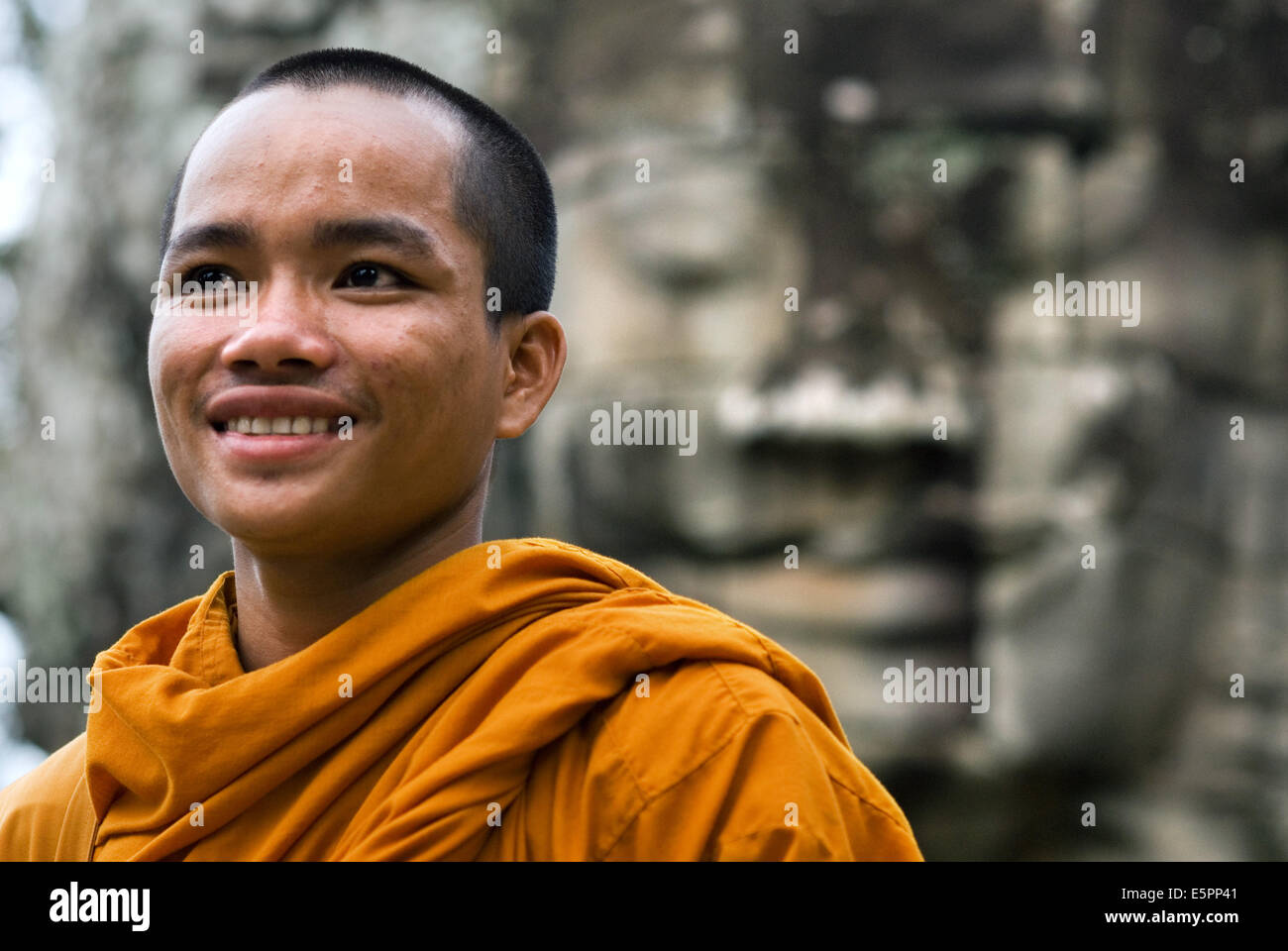 Buddhist monks in the inner part of Bayon temple. Angkor Thom. Angkor Thom was built as a square, the sides of which - Stock Image