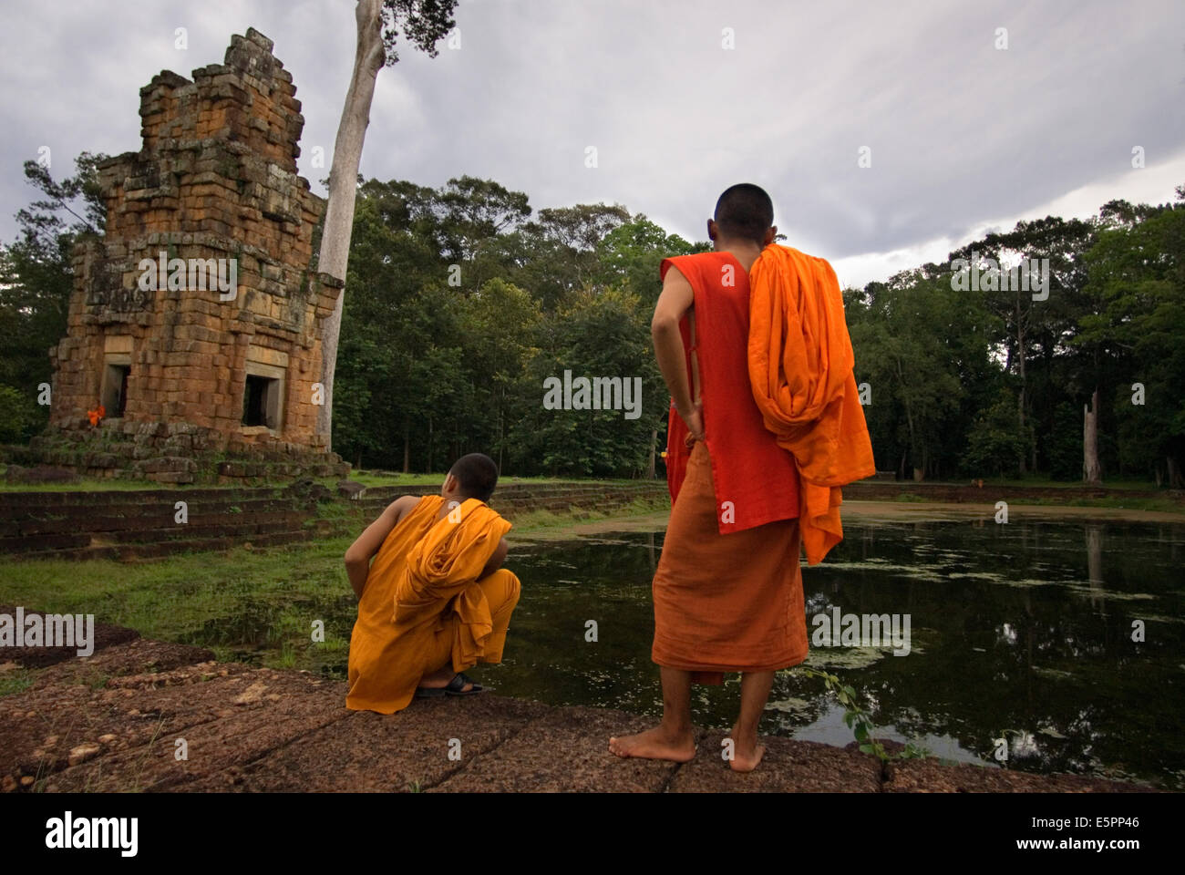 Buddhist Monk at the Temples of  Kleangs & Prasat Suor Prat. Angkor Thom. Rectangular sandstone building set - Stock Image