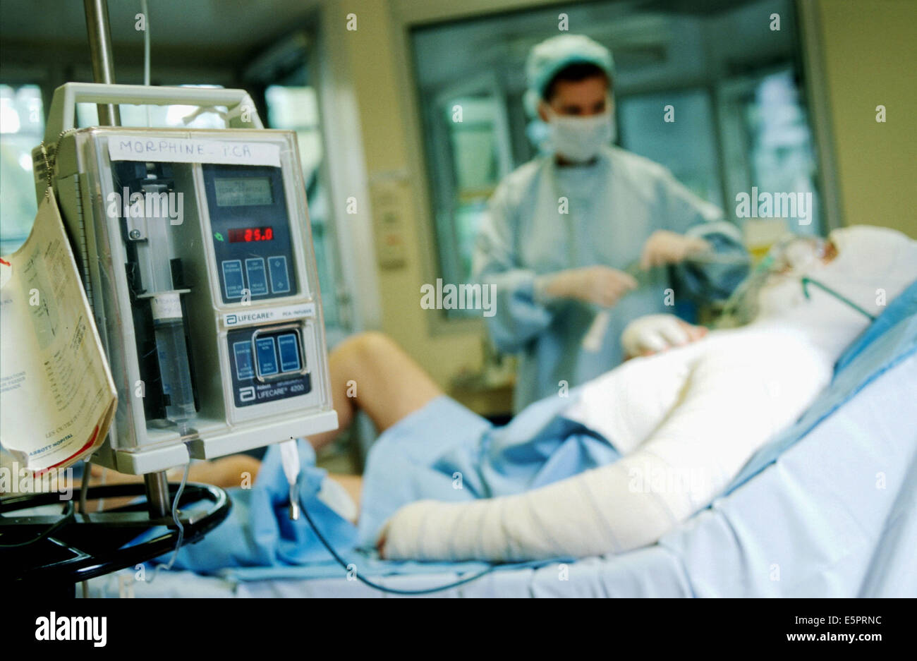 A severely burned patient manages pain treatment with a self-controlled morphin pump, Burn center, Military Percy - Stock Image