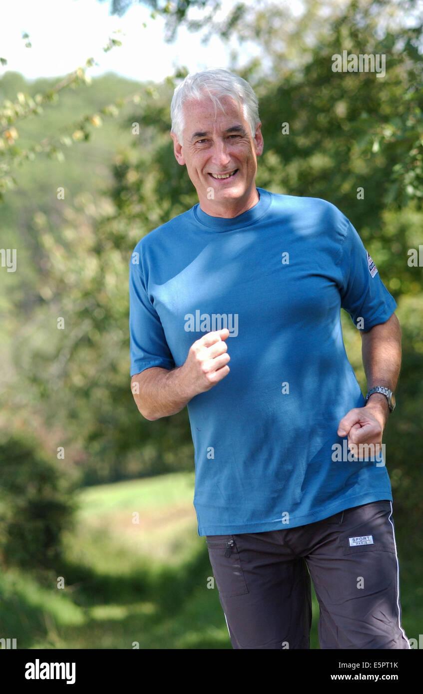 60-year-old man running. - Stock Image
