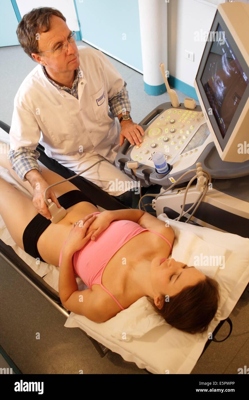 Woman undergoing pelvic ultrasound scan. - Stock Image
