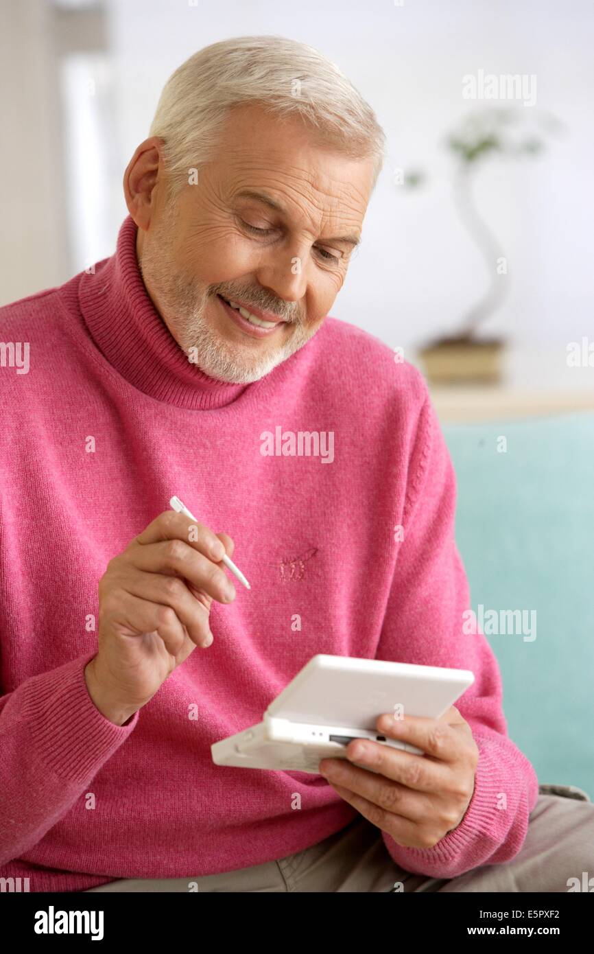 Man playing video game console. - Stock Image