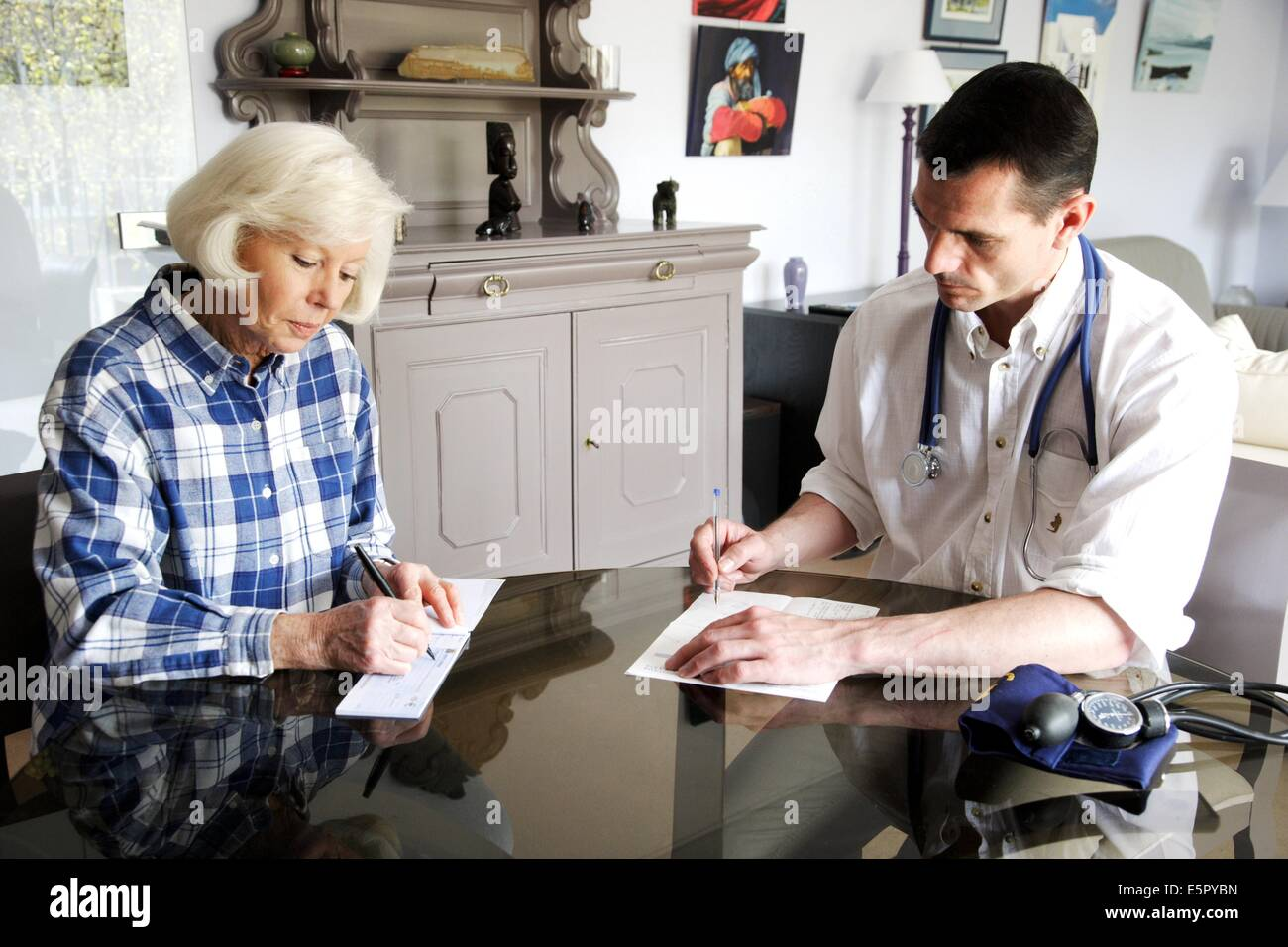 Patient paying consultation fees. - Stock Image