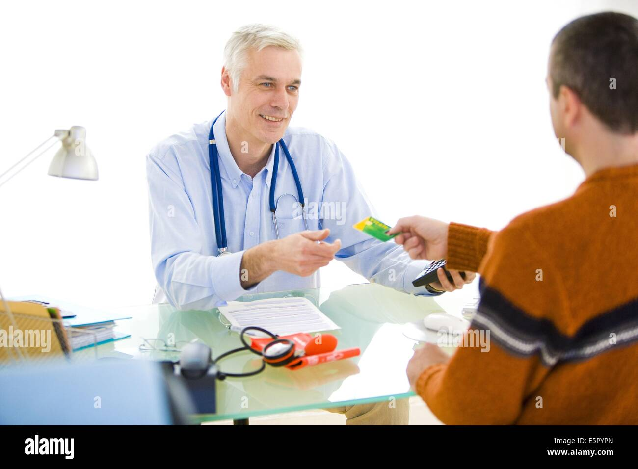 Patient presenting his health card (Carte Vitale 2) in consultation. - Stock Image