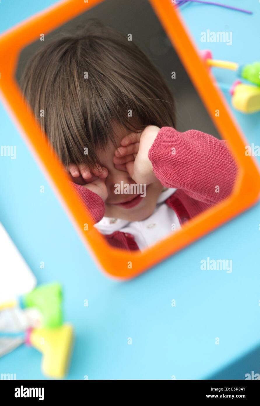 5 year old girl during speech therapy session. - Stock Image