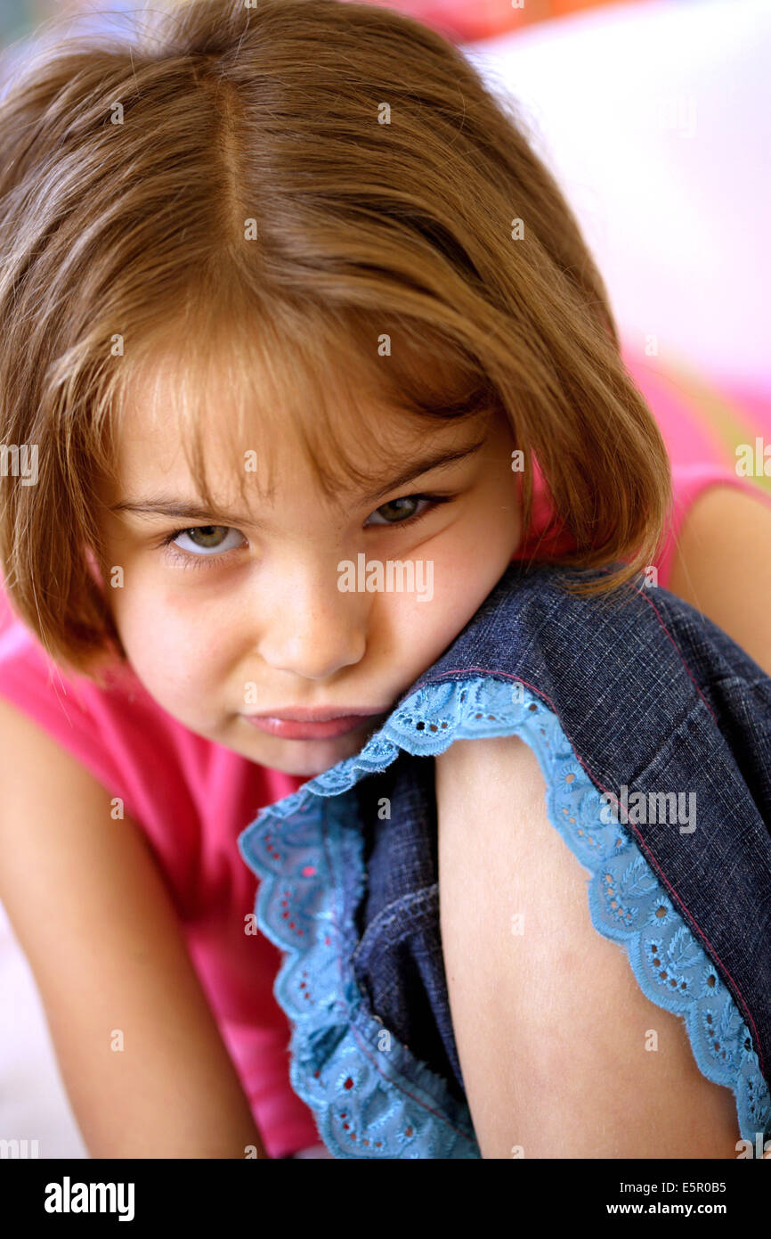 Young girl looking sullen. - Stock Image