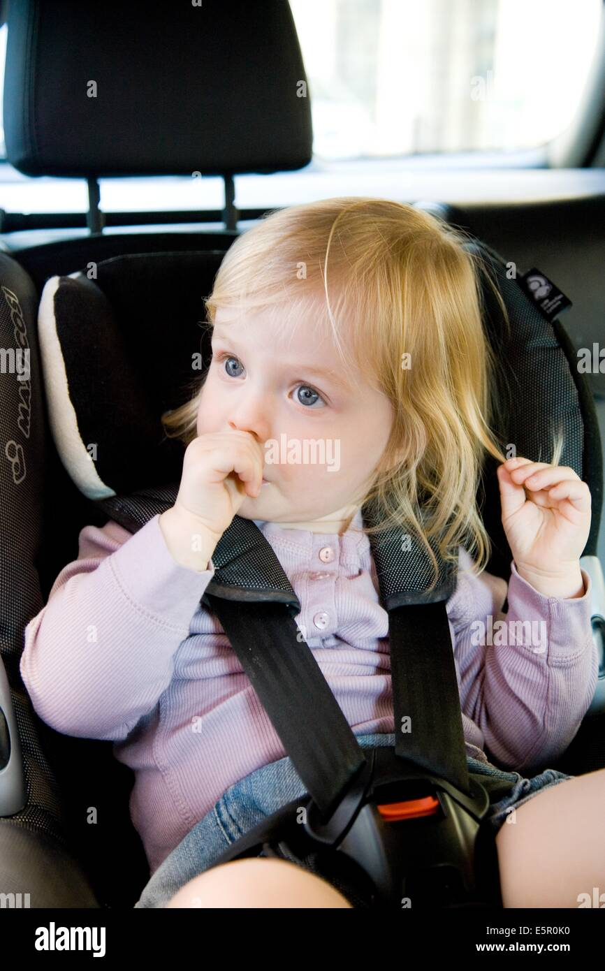 2 year old baby in a baby car-seat Stock Photo: 72420180 - Alamy