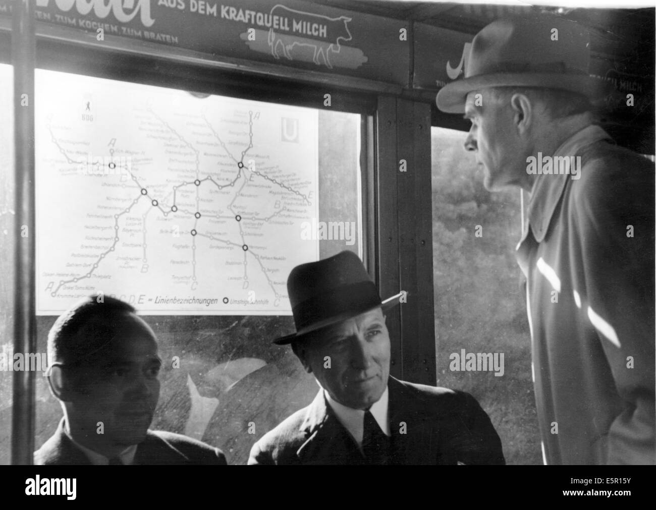 Berlin Subway Map Poster.Passengers Look At A Map Of The Berlin Metro In A Glass Case In