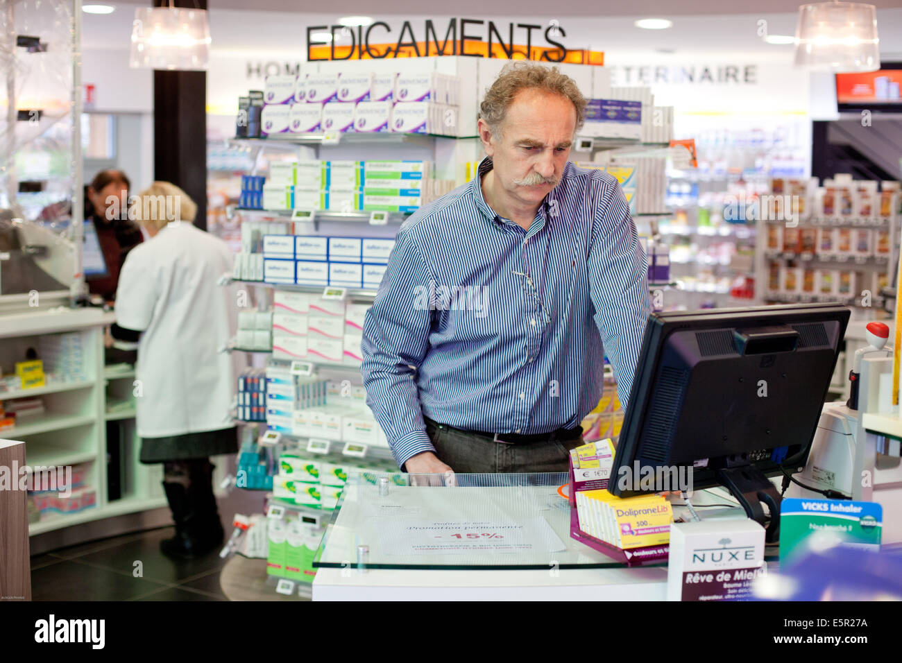 Pharmacist using a computer. - Stock Image