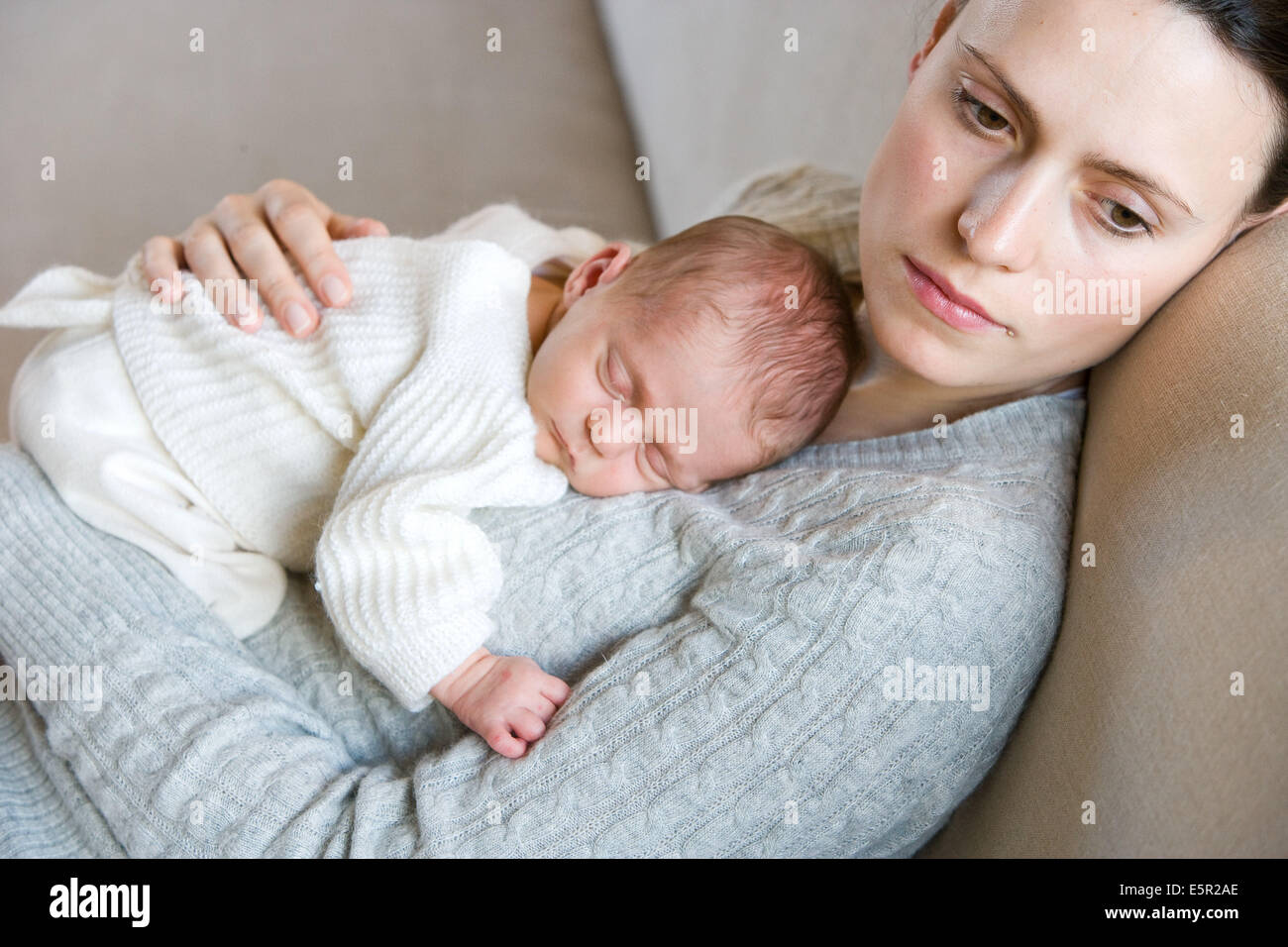 3 week old baby with his mother. - Stock Image