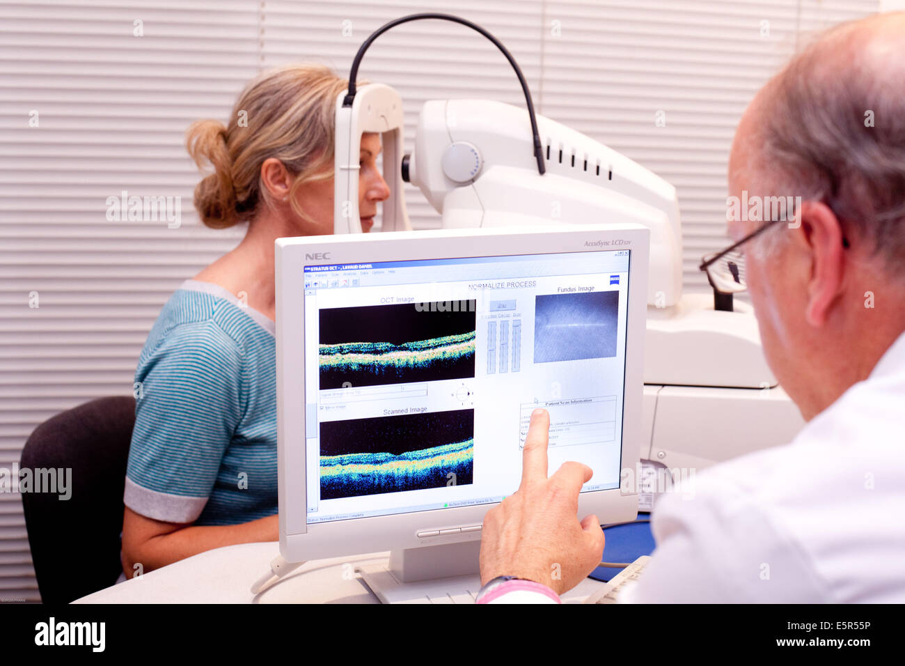 O.C.T (Optical Coherence Tomography) scan of section through the retina. This digital diagnostic technique makes - Stock Image