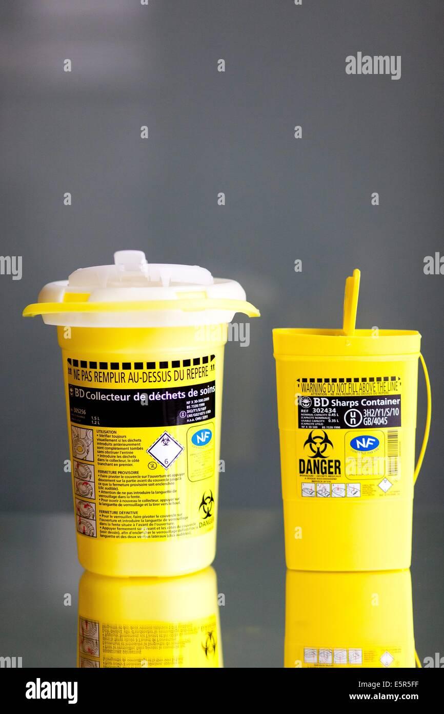 Contaminated sharps and medical waste disposal. - Stock Image