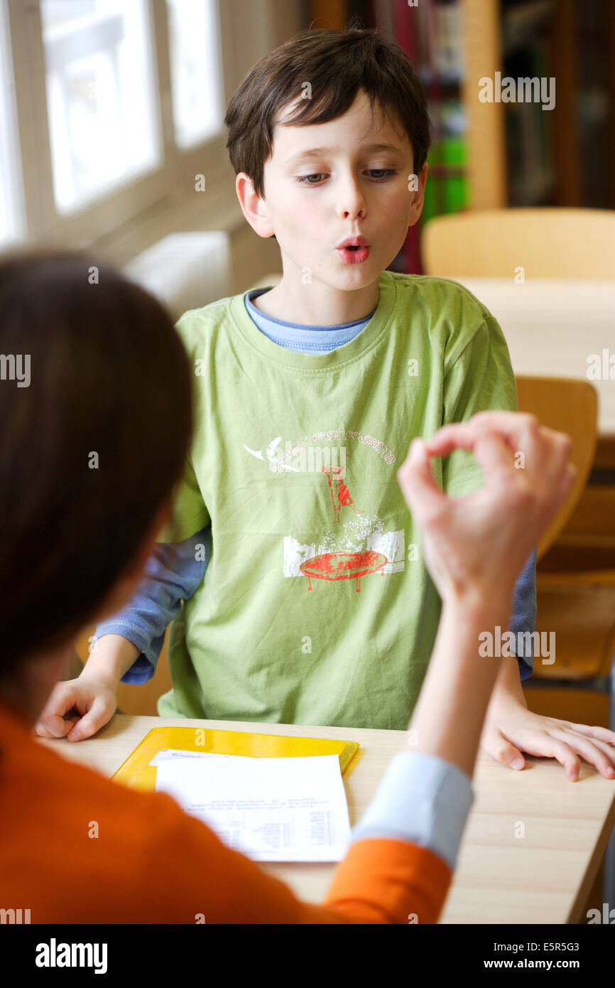 8 Year Boy Bedroom Design: 8 Year, Old Boy During Speech Therapy Session Stock Photo