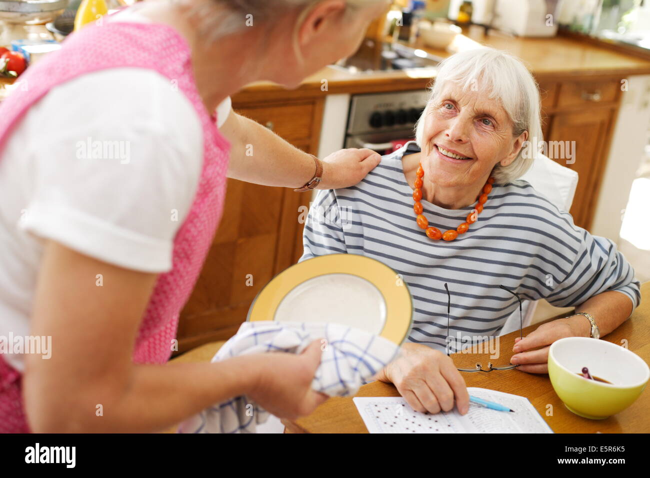 80 year old woman with a home care attendant. - Stock Image