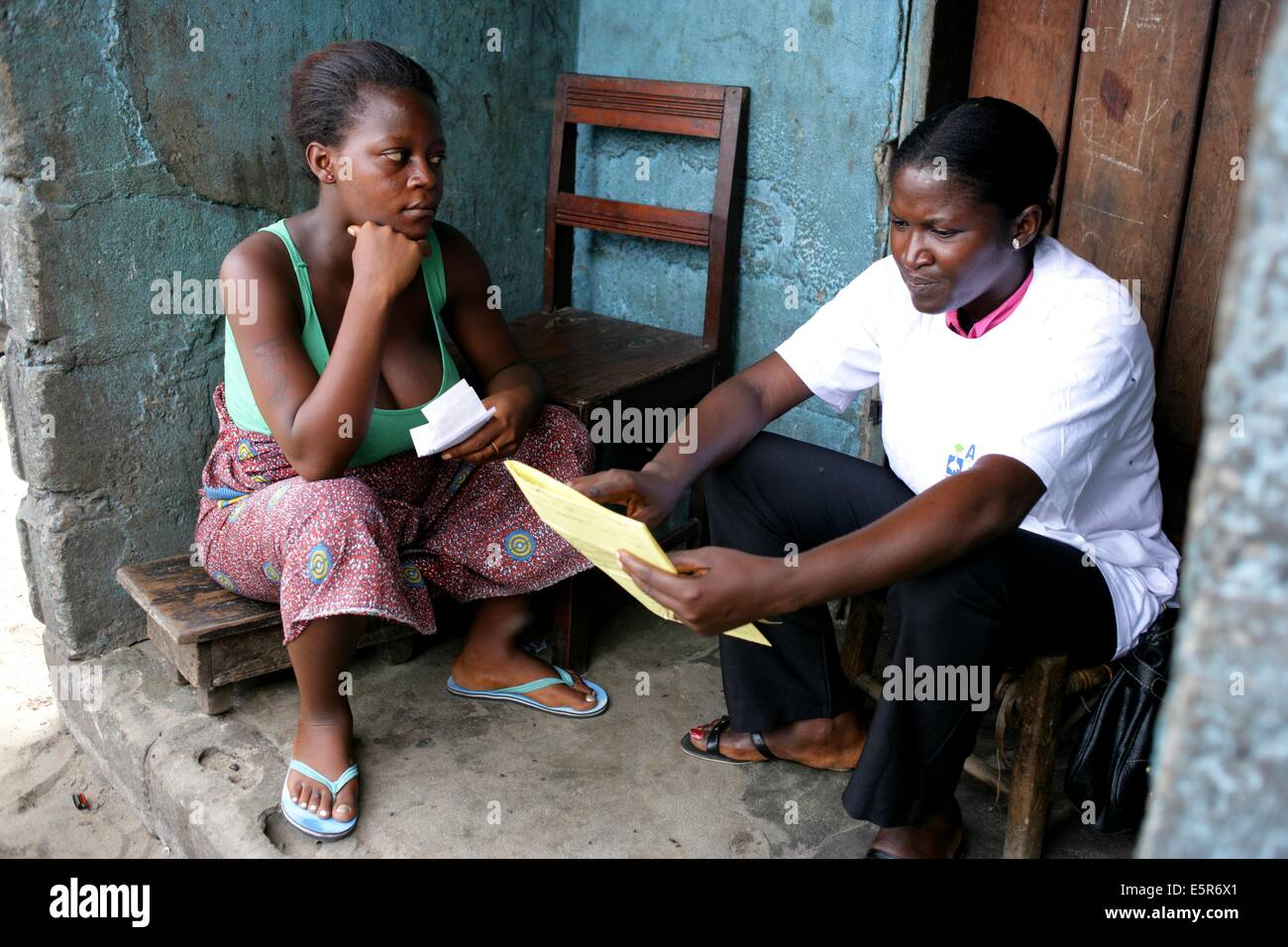 A social worker visits a young pregnant woman, Program for prevention of malnutrition implemented by Action Contre - Stock Image