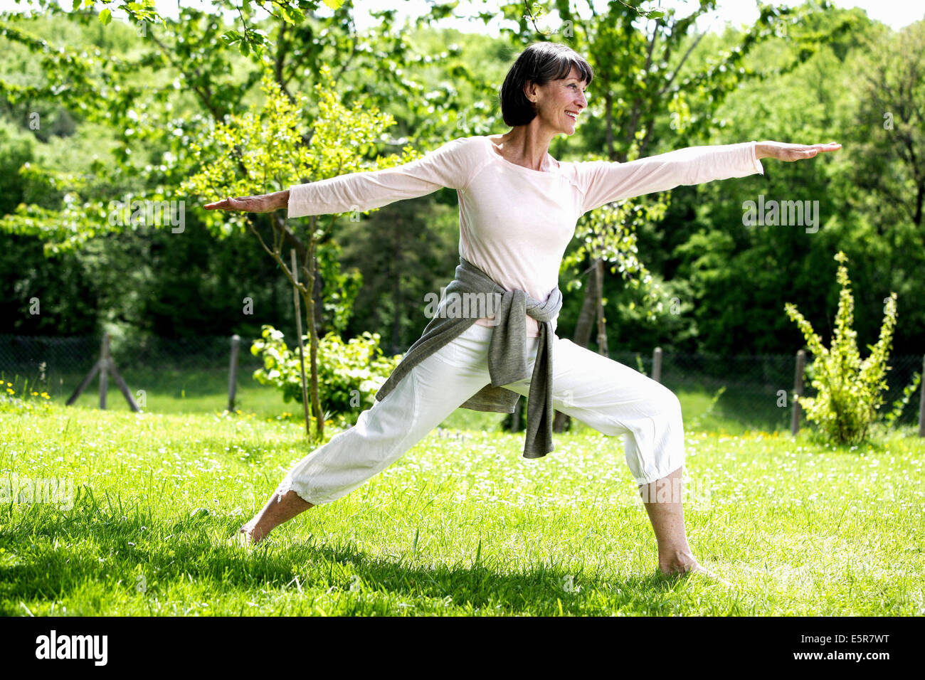 Woman practicing Tai chi. - Stock Image