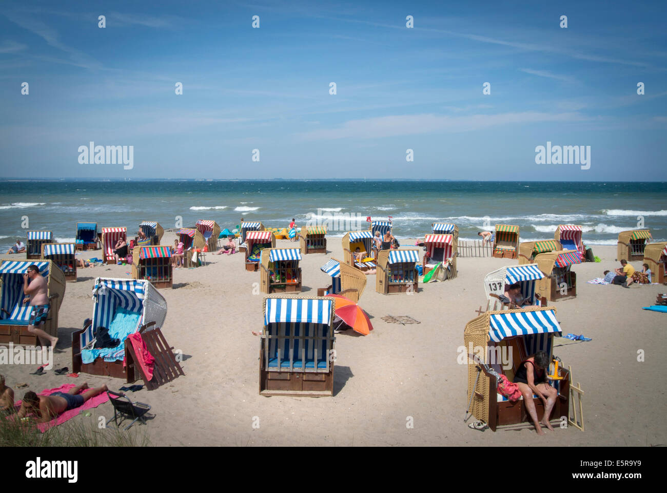 Holiday Makers at Neindorf beach, Niendorf is a traditional German holiday location on the Baltic Coast in Northern - Stock Image