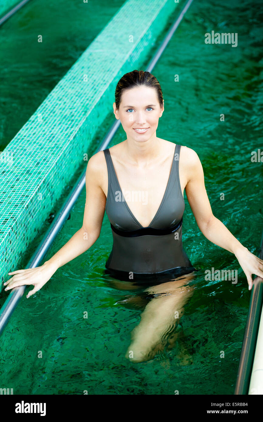 Woman walking in a countercurrent pool for treatment of venous insufficiency. - Stock Image
