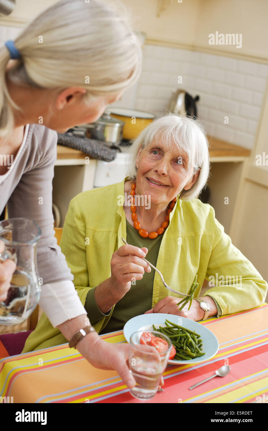 80 year old woman having lunch at home Stock Photo: 72430256 - Alamy