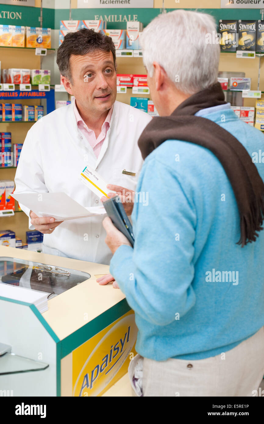 Man buying Tamiflu (oseltamivir) influenza drug in pharmacy. - Stock Image