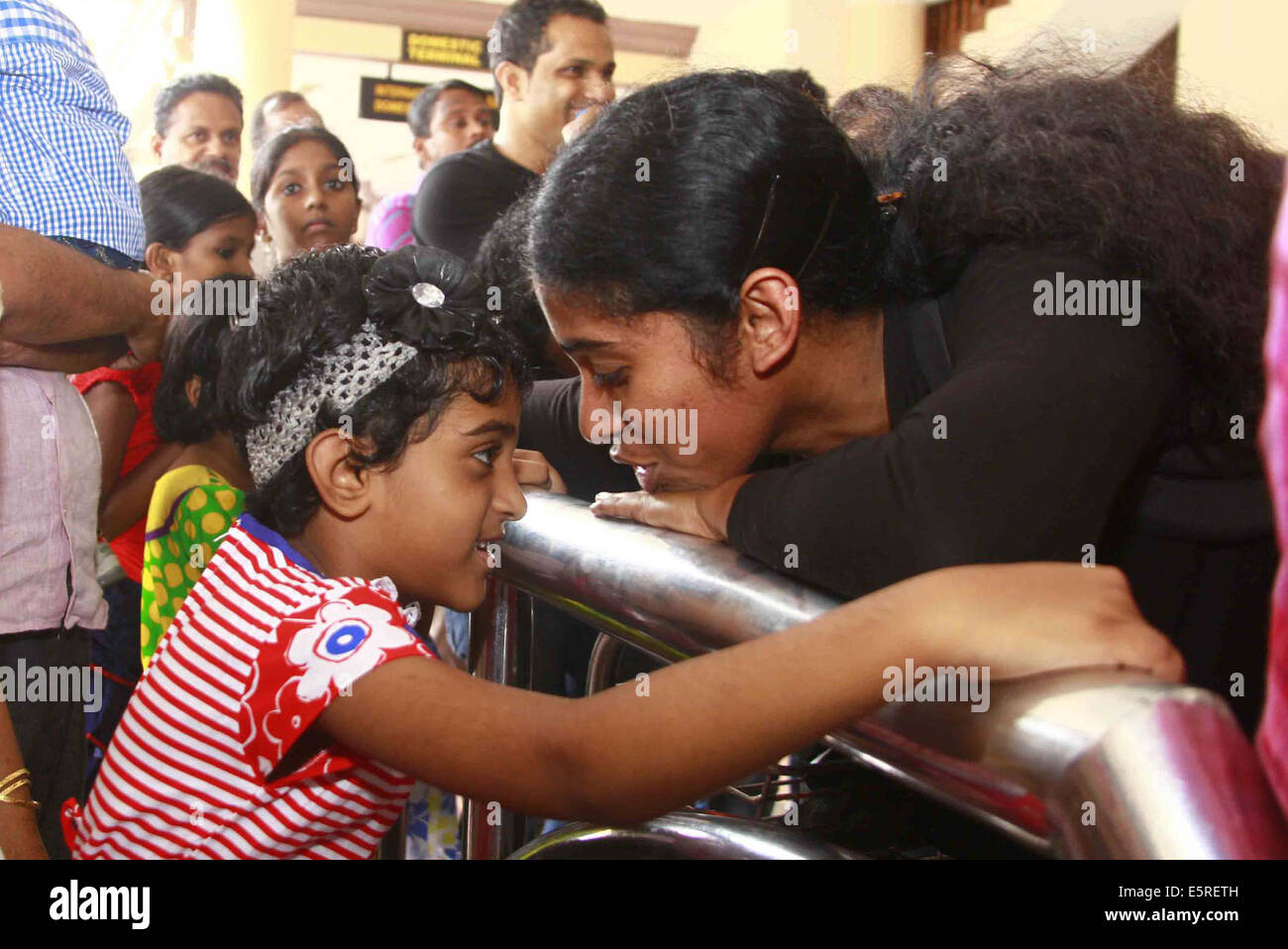 Kochi. 5th Aug, 2014. One of the 44 Indian nurses evacuated from war torn country Libya talks to her daughter on - Stock Image