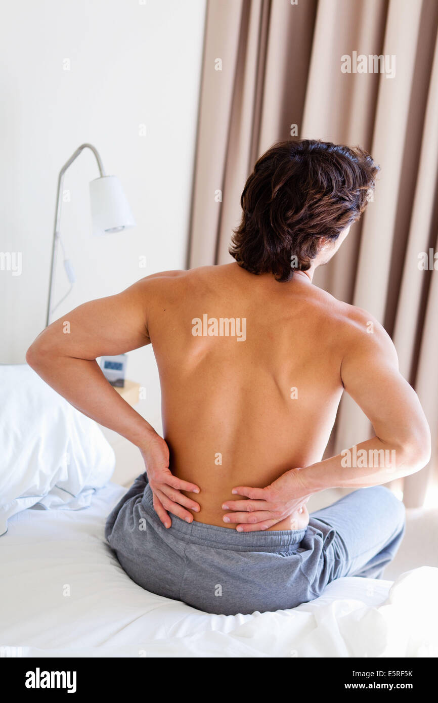 Man suffering from lumbar pain. - Stock Image