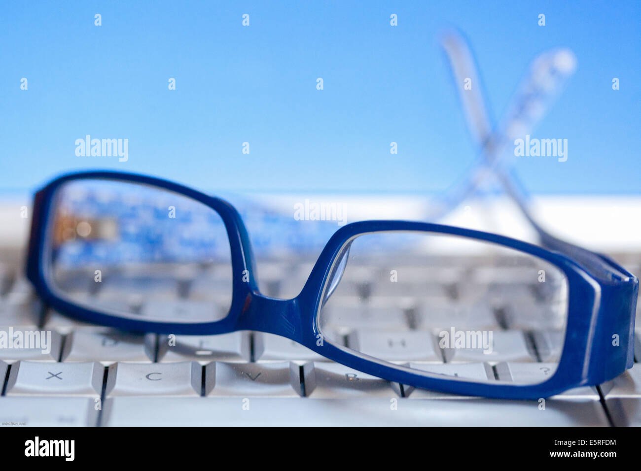 Glasses and computer. - Stock Image