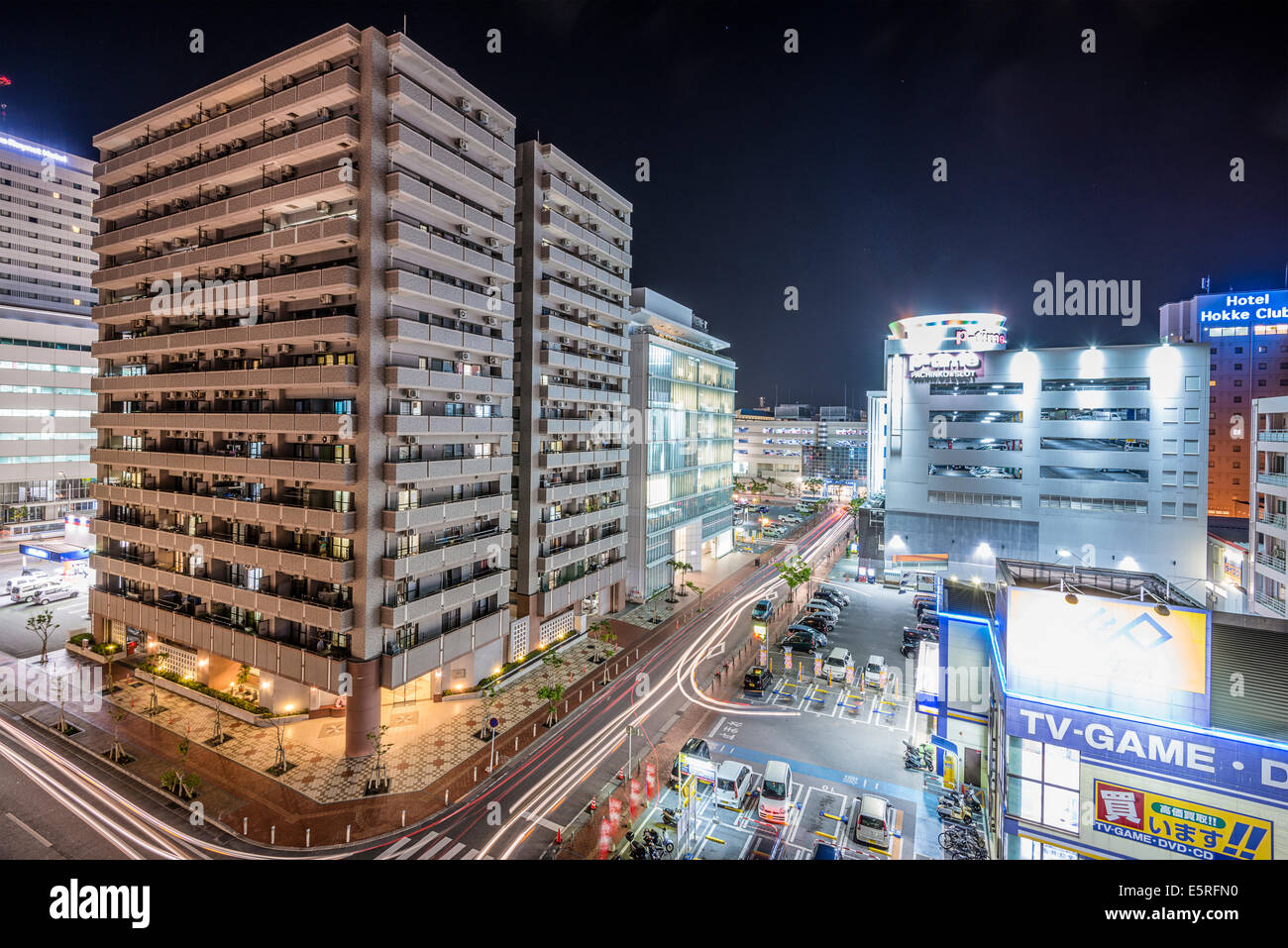 NAHA, JAPAN - NOVEMBER 12, 2014: Apartments and shops in downtown Naha, Okinawa. The city is the most populous in - Stock Image