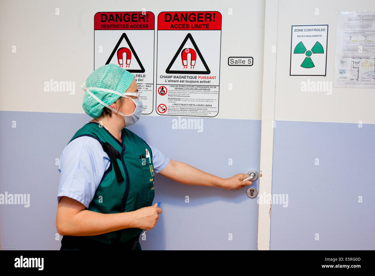 Radiation warning sign in radiology department at hospital. - Stock Image