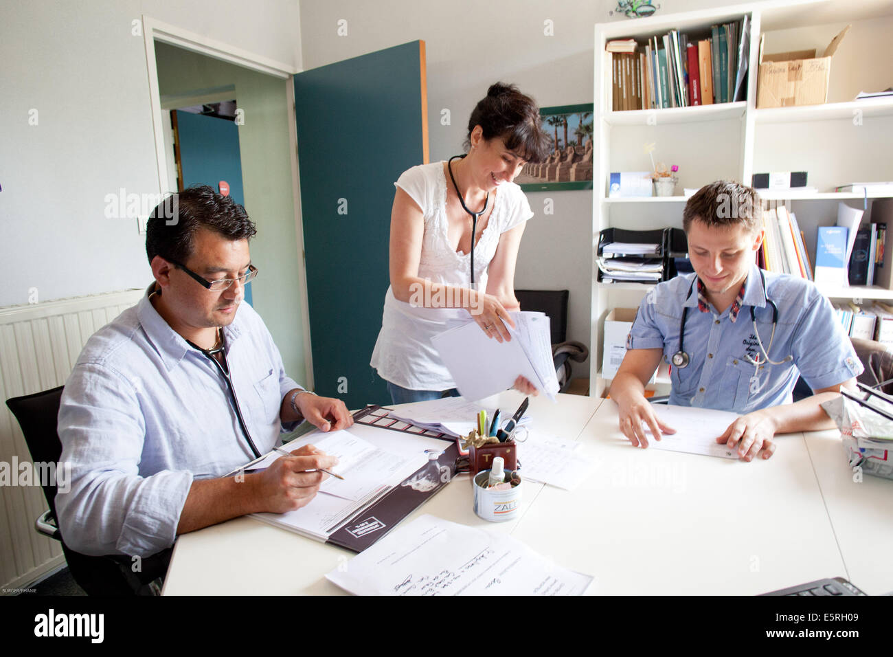 Meeting of associated general practitioners in a medical office, Dordogne, France. - Stock Image