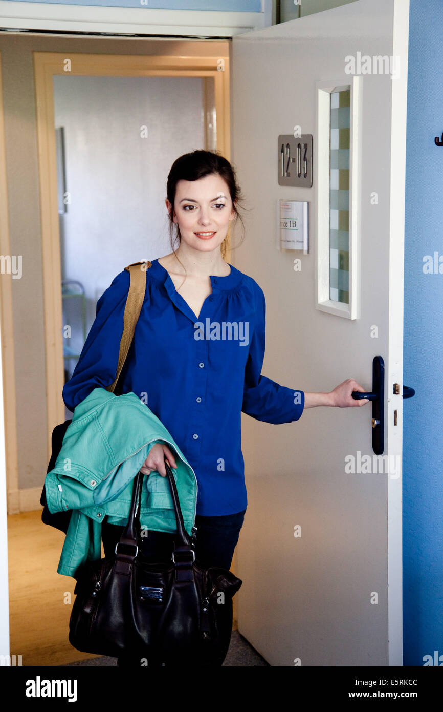 Woman entering hospital room for long term stay. - Stock Image