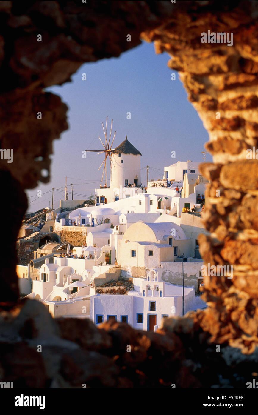 Greece, Santorini, Ia, view over town through stone window - Stock Image