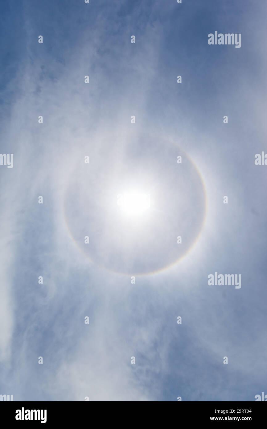 Luminous halo around the Sun, optical phenomenon. - Stock Image
