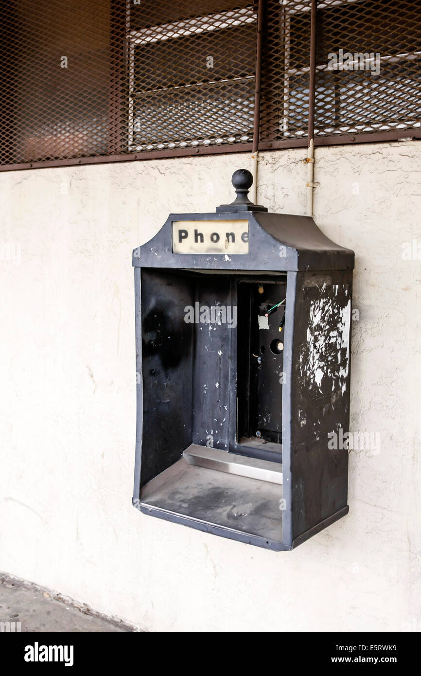 A now dismantled public phone kiosk in Ybor City Tampa FL - Stock Image