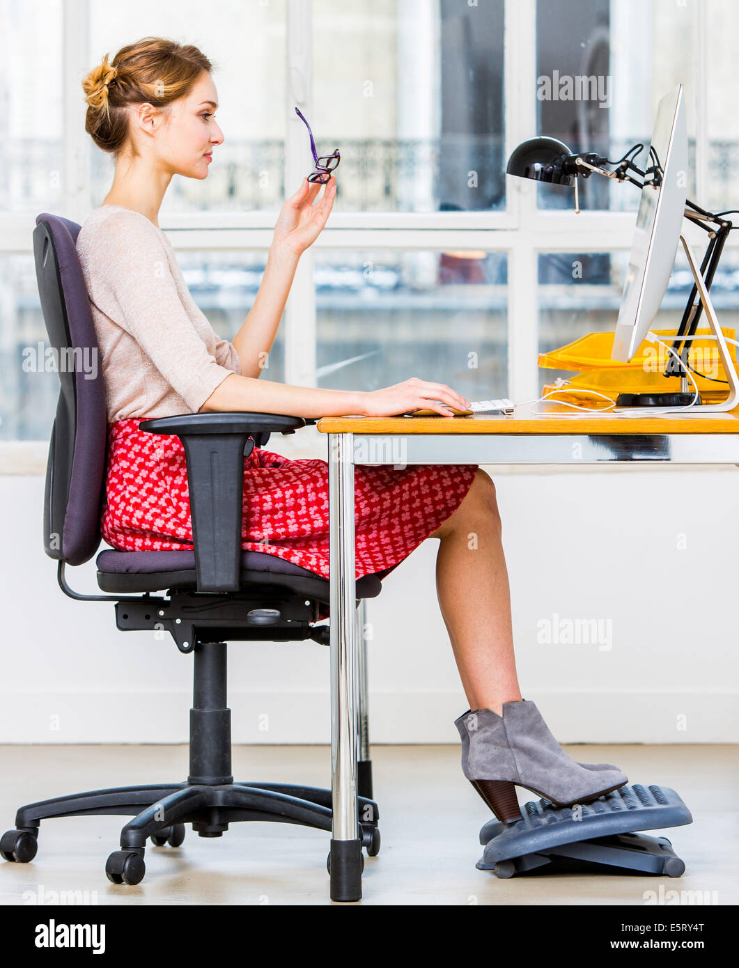 Right posture for working at a computer. - Stock Image