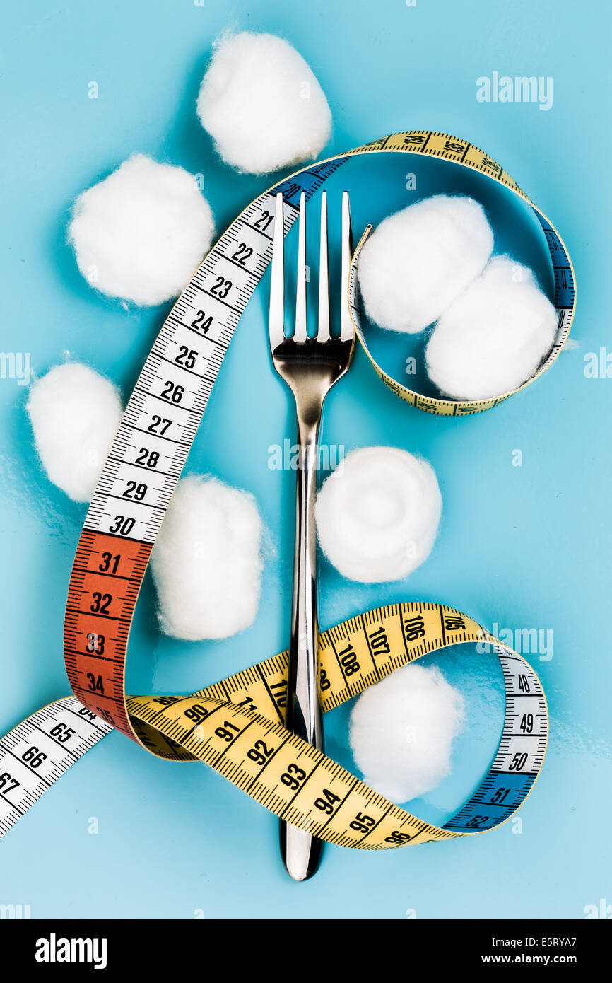 Cotton-wool ball diet. - Stock Image