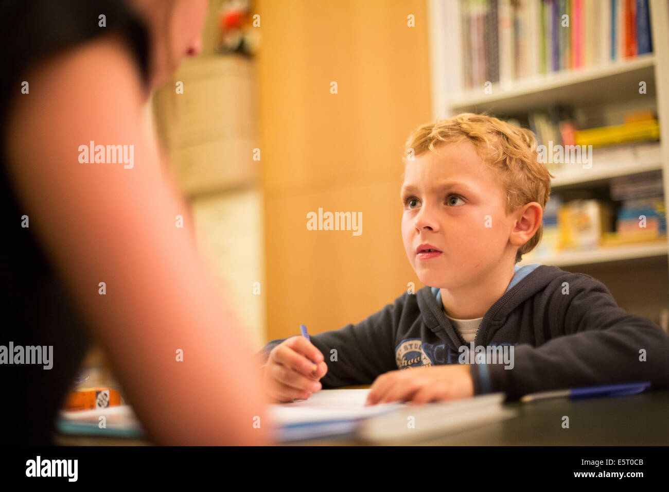 Child in a session with a speech therapist. - Stock Image