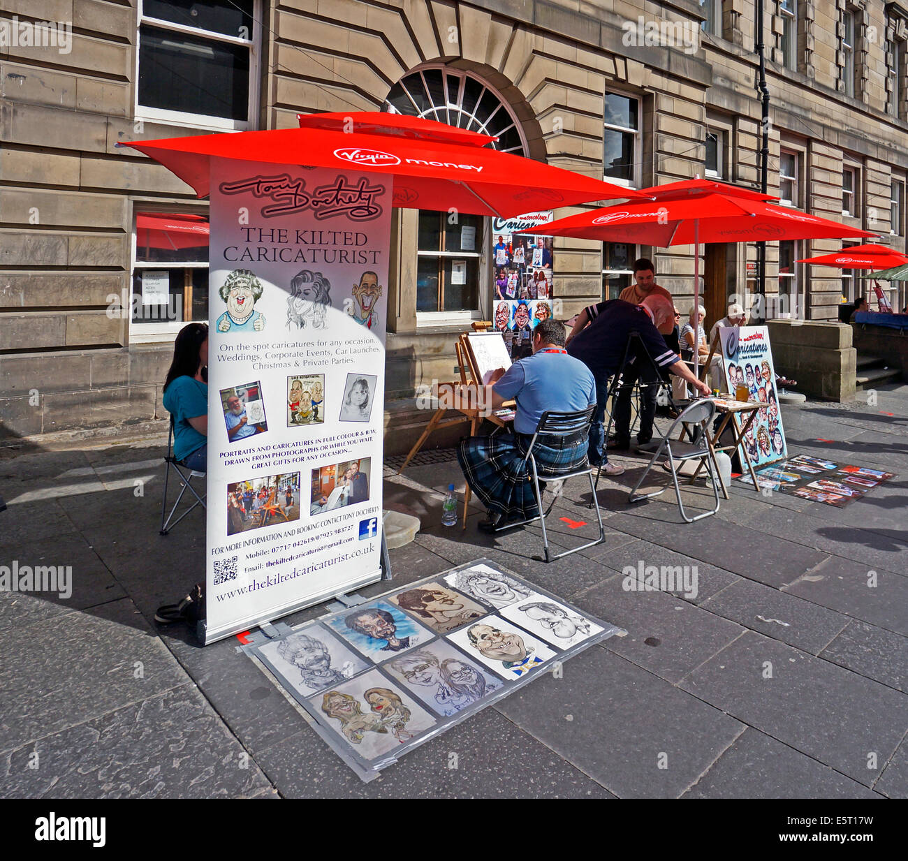 Edinburgh Fringe Festival 2014 caricature painters in High Street The Royal Mile Edinburgh Scotland - Stock Image