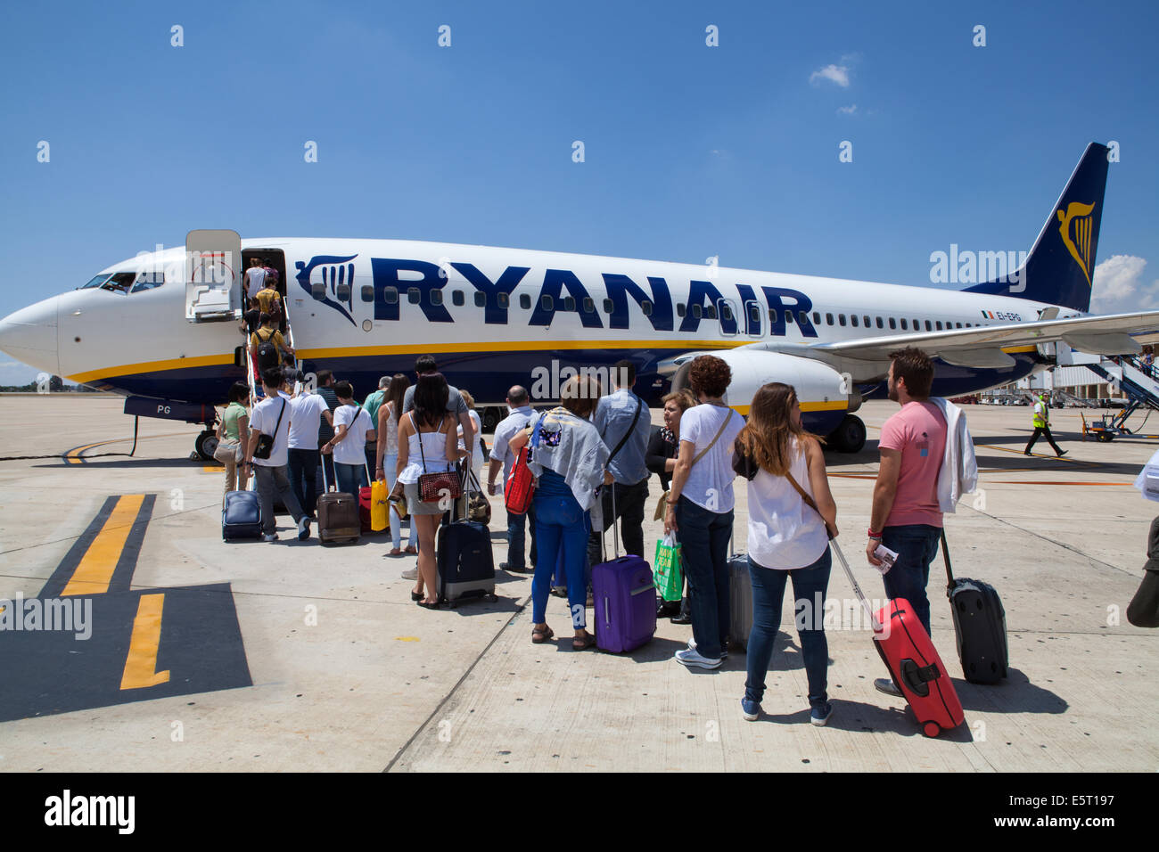Passengers board a Ryanair flight at Seville airport - Stock Image