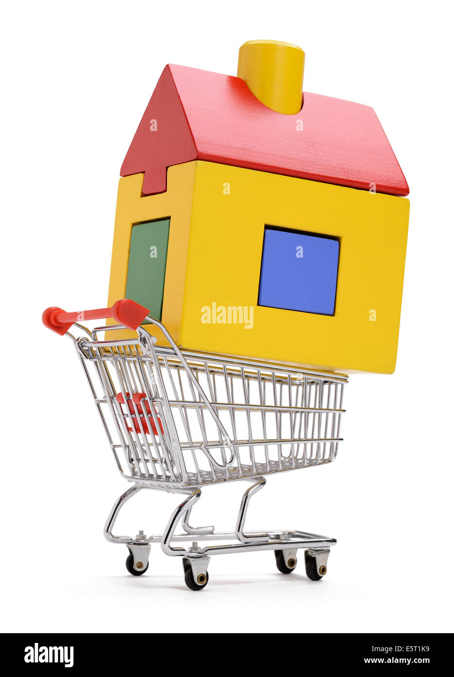 A toy wooden house in a shopping trolley - Stock Image