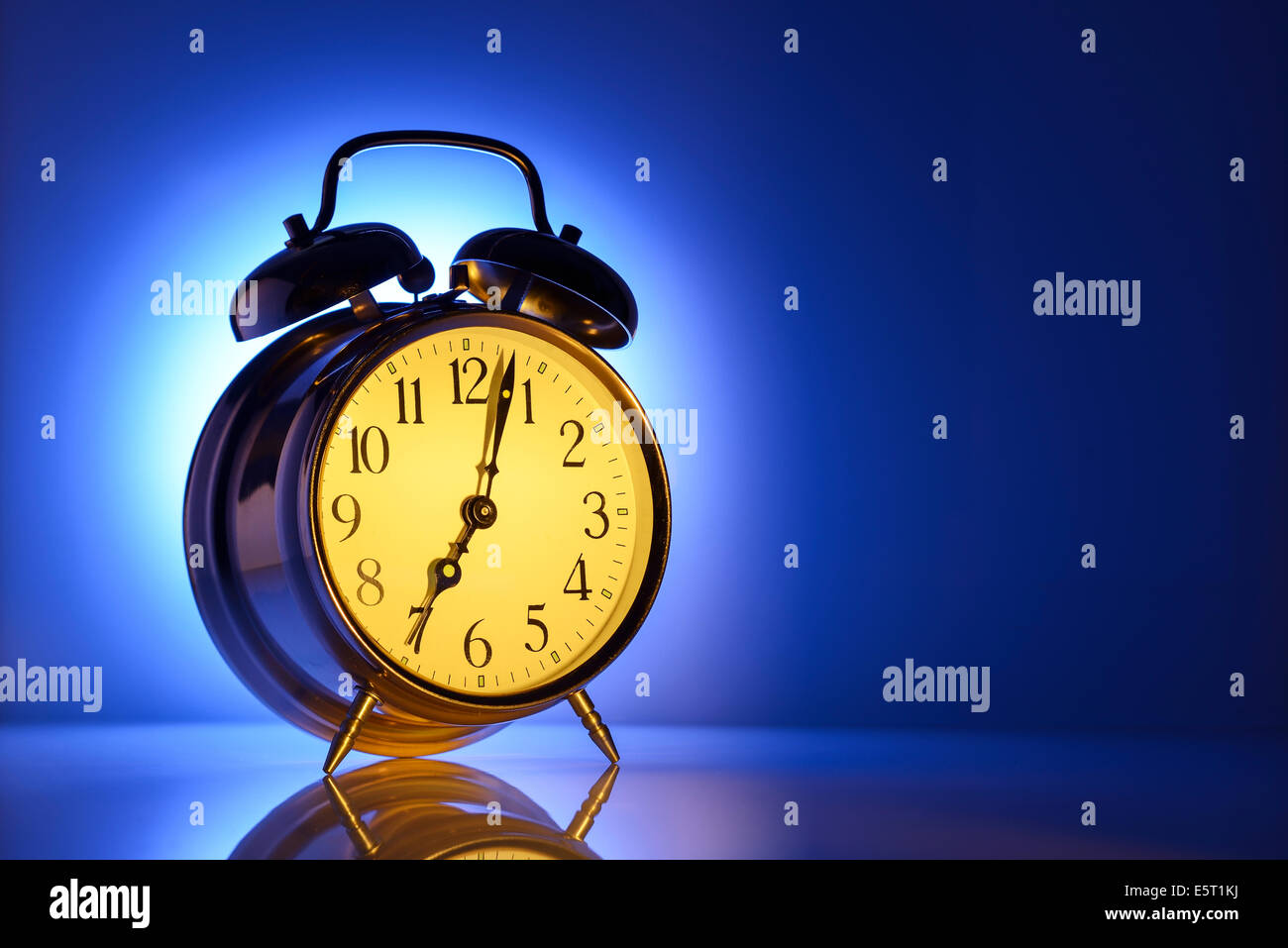 A classic alarm clock set for 7am - Stock Image