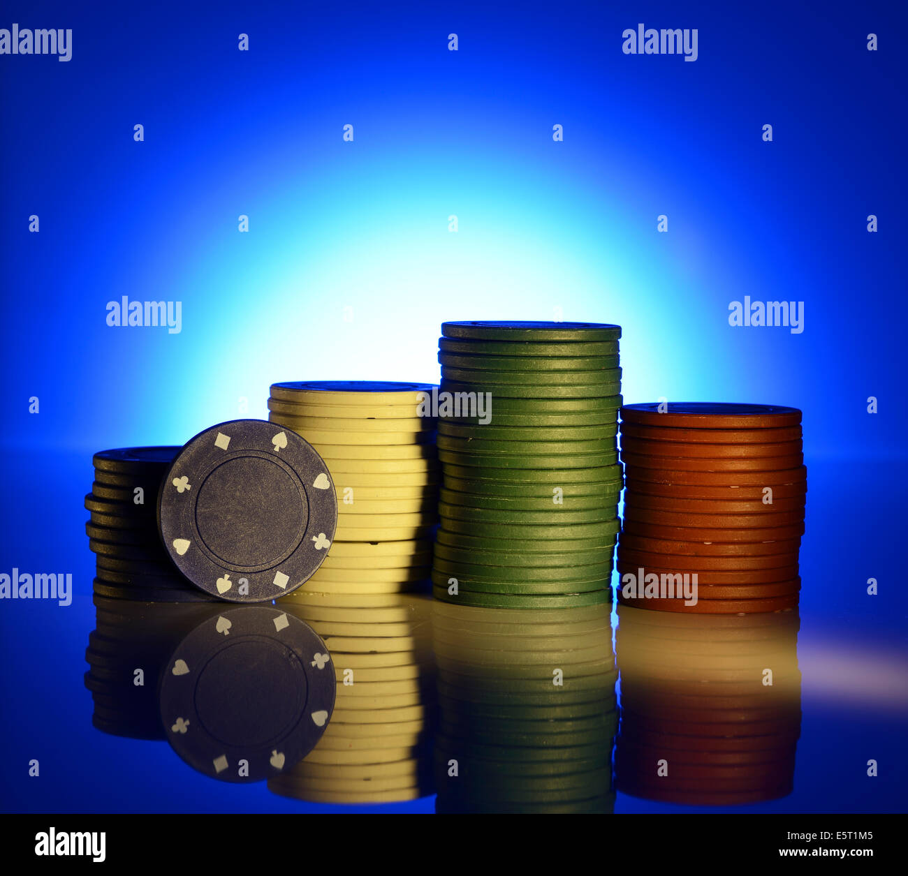 Spotlight on a stack of poker chips - Stock Image