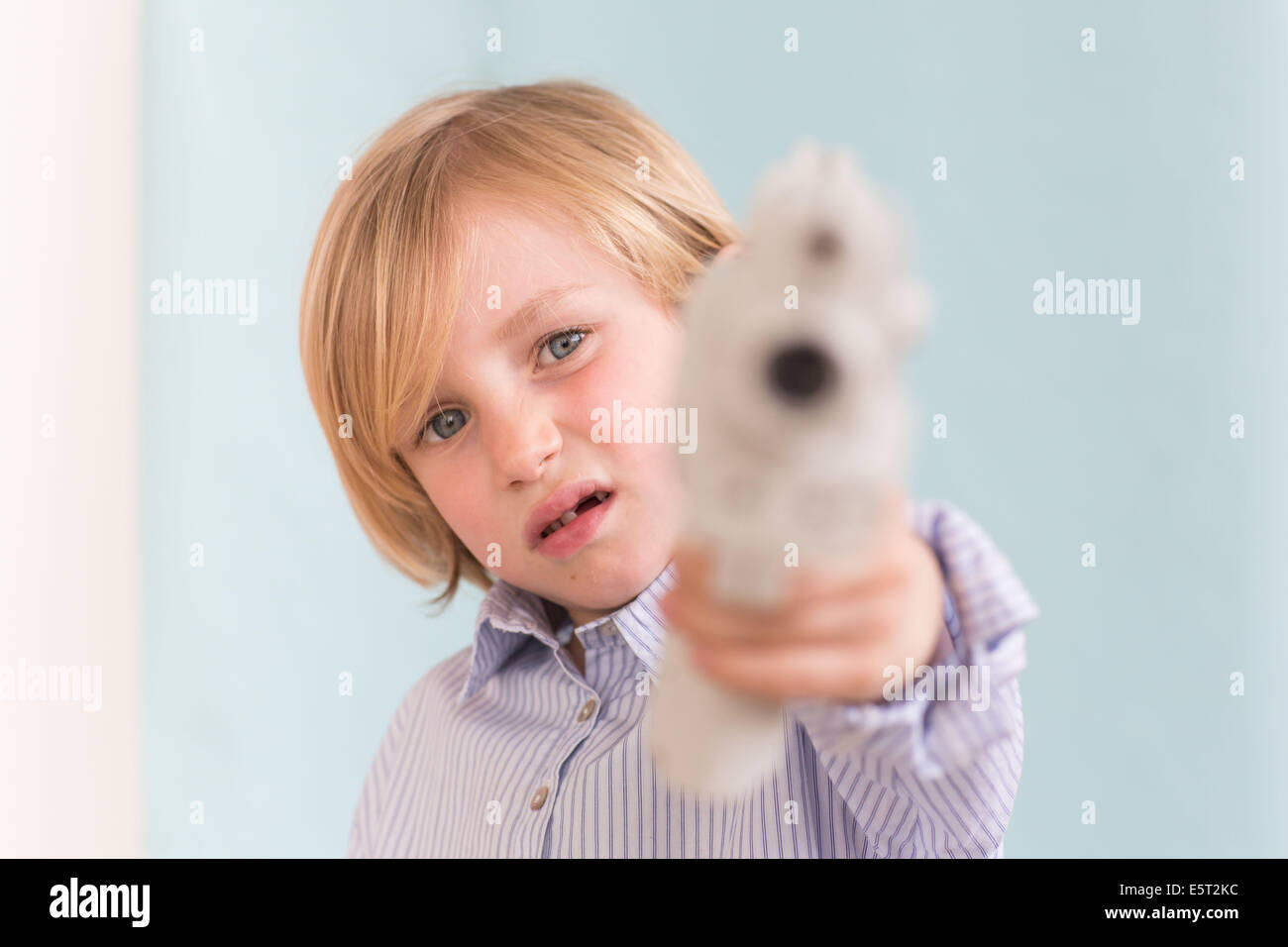 7 year old boy playing with toy. - Stock Image