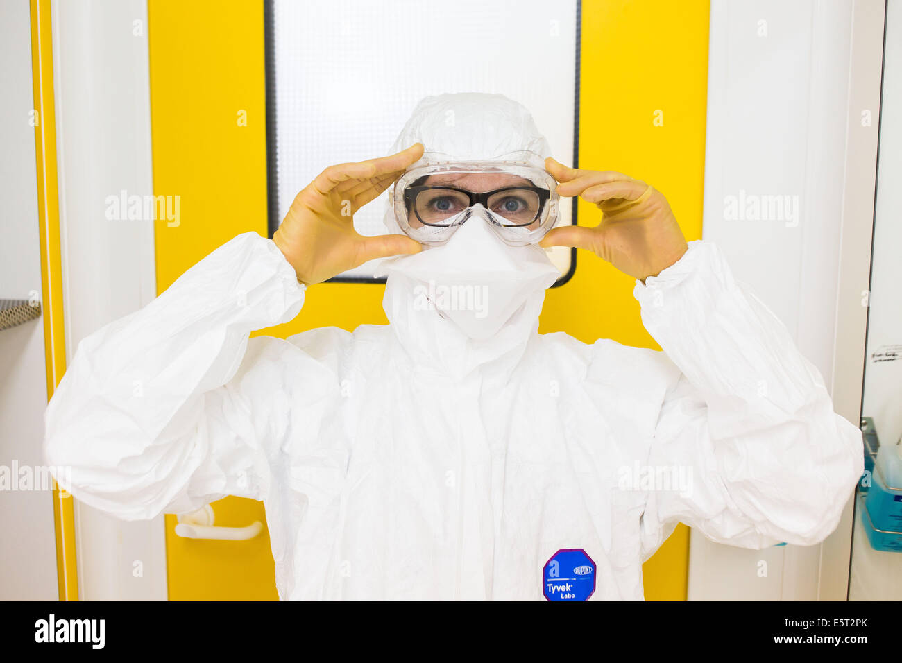 Cleanroom dressing procedure, French Army Blood Transfusion Service (CTSA) in Clamart, France. - Stock Image